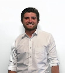 A person standing posing for the camera  Description automatically generated